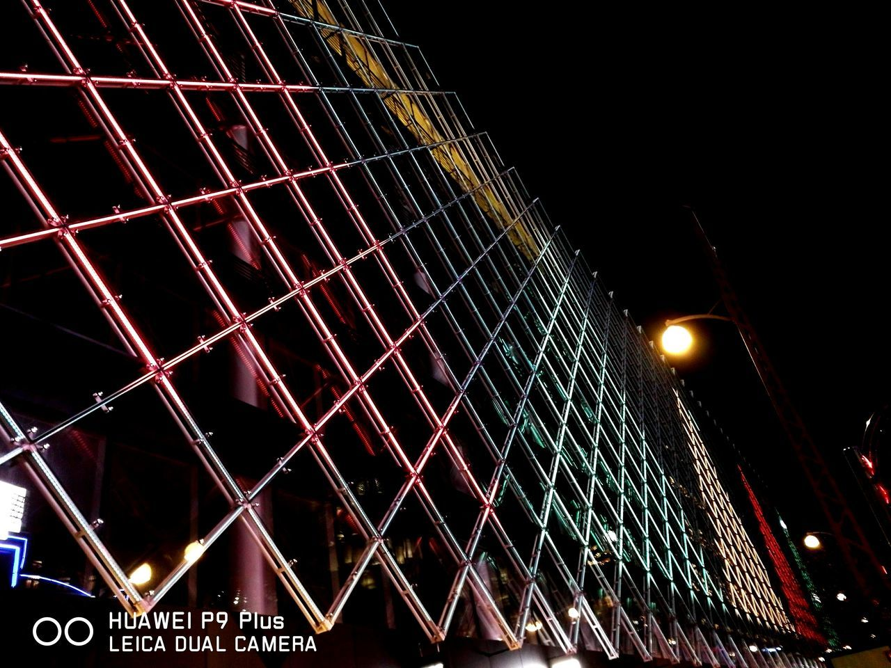 night, illuminated, low angle view, architecture, lighting equipment, built structure, outdoors, no people, clear sky, sky, building exterior, city
