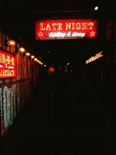 Illuminated text on wall at night