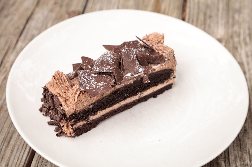 Moist devils food chocolate cake called Parisian cake with a chocolate mousse frosting and dark chocolate flakes. Chocolate Confection Dessert Parisian Cake Parisian Cream Chocolate Chocolate Cake Chocolate Flakes Chocolate Mousse Chocolate Mousse Cake Close-up Confectionery Devils Food Cake Extravagance Food Food And Drink Freshness Indoors  Indulgence Indulgent Pastry Plate Ready-to-eat Sweet Food Sweets