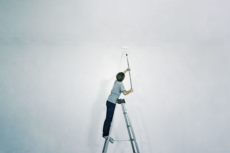 Adult Day Full Length Indoors  Ladder Men Occupation One Man Only One Person Paint Roller Painter People Real People Shadow Standing Studio Shot White Background White Wall Women