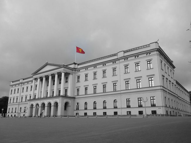 The Royal Palace in Oslo, Norway. Black And White With A Splash Of Colour Castle Cloudy Norway Oslo Architecture Building Exterior Built Structure Flag Government Grey Sky Outdoors Palace Patriotism Red Flag Royal Palace Royalty Slott