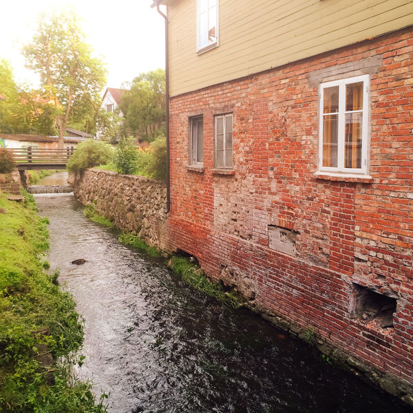 Aleksupite river winding through town, Kuldiga. Latvia Abandoned Architecture Brick Wall Building Exterior Built Structure Day Deterioration Flowing House Kuldiga Latvia Narrow No People Obsolete Old Outdoors Residential Structure River Stone Stone Wall Stream Town Village Wall Window