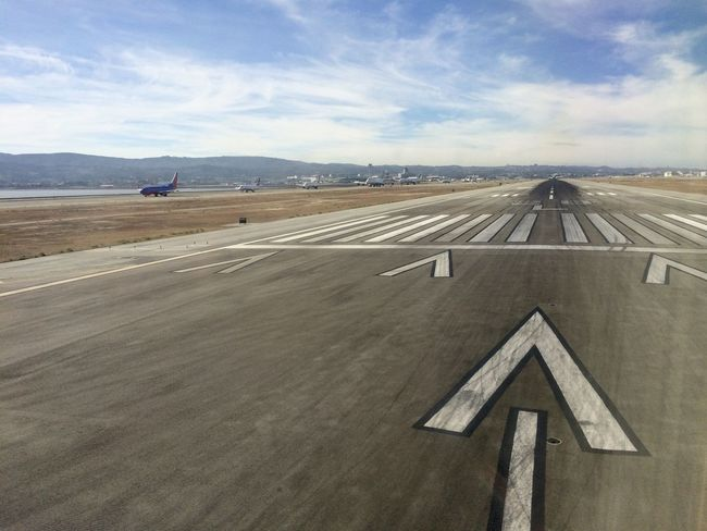 Aerospace Industry Airplane Airport Airport Runway Arrow Day No People Outdoors Road Runway Sky