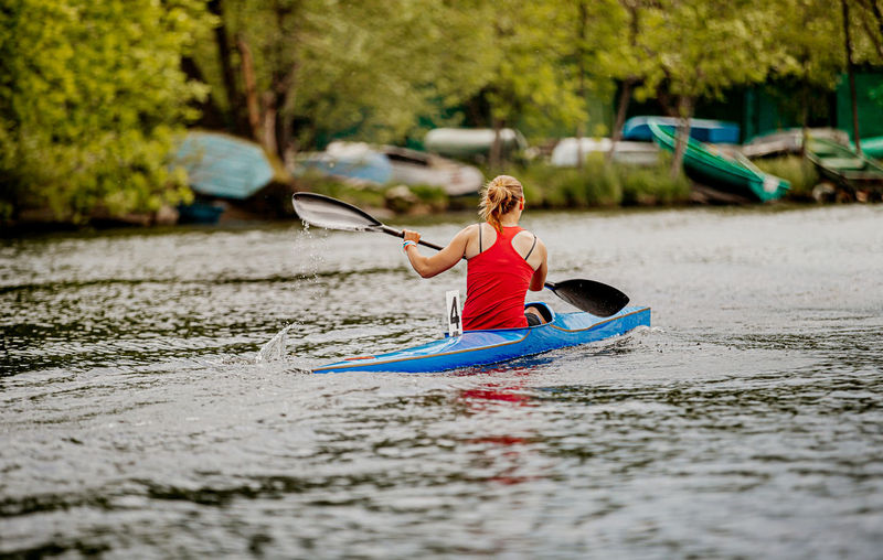 Full length of woman in boat on lake