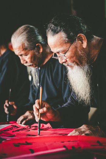 Vietnamese Calligraphy: Old Scholars are writing Calligraphy on Lunar December 21th at the Big House, an acient-style architecture with brick and wood at Long Son, VungTau City, Documentary Editorial 2017 Art, Drawing, Creativity Artist Brush Calligraphy Calligraphy, Handwriting, Script, Penmanship, Hand, Pen Culture, History Handwriting  Hollidays Human Hand Lunar New Year New Year Paintbrush Paper Red Scholar Traditional Vietnamese Vungtau Vietnam Writing Writing On Red Paper First Eyeem Photo