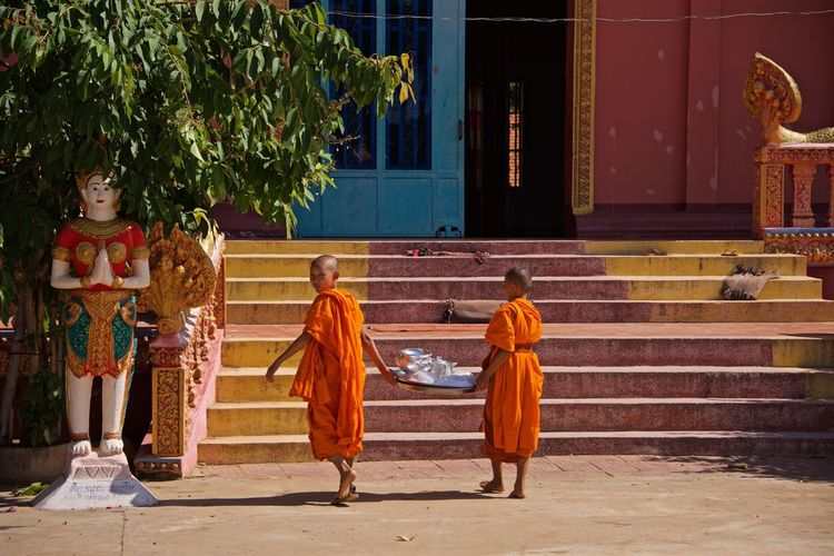 Asian Culture Cambodia Architecture Boys Building Exterior Child Childhood Children Only Color Colorful Day Full Length Monk  Monks Monks In Temple Monks Walk Outdoors People Real People Religion Spirituality Steps Togetherness Tree Two People The Traveler - 2018 EyeEm Awards