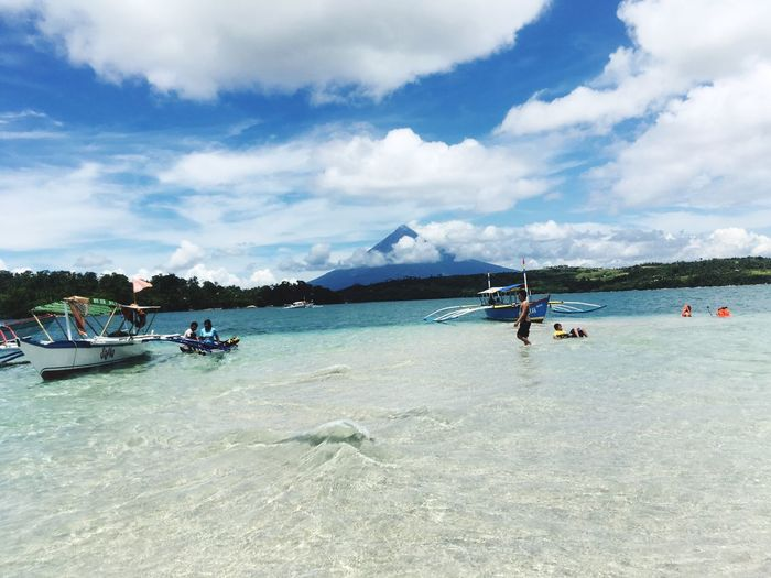 Beauty of Mayon Sky Water Sea Scenics Nature Cloud - Sky Beauty In Nature Mountain Real People Vacations Beach Leisure Activity Day Lifestyles Nautical Vessel Outdoors Men Transportation Adventure Mountain Range Philippines Bicol, Philippines