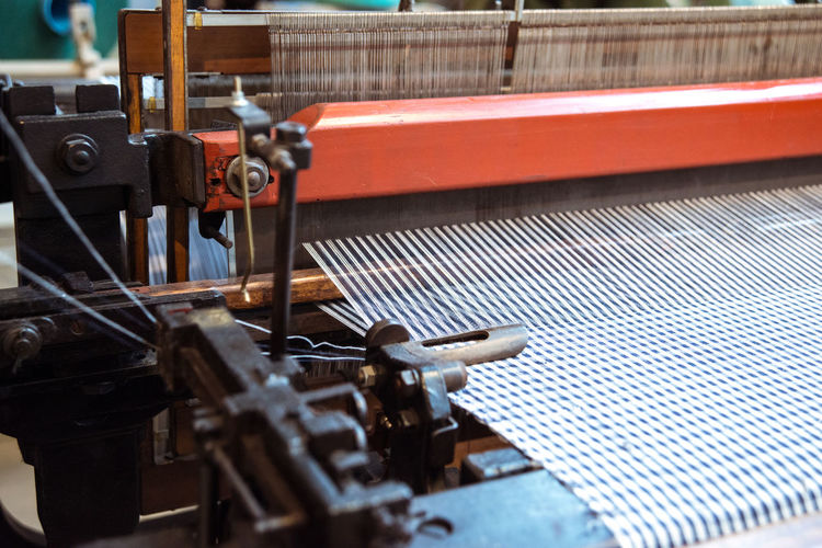 Close-up of weaving machine in museum