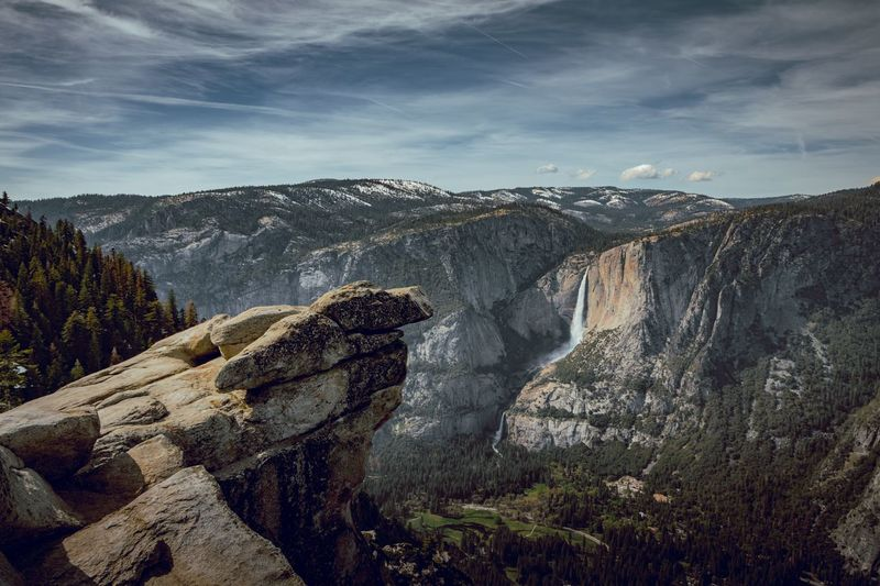 Scenic View Of Yosemite National Park Against Cloudy Sky