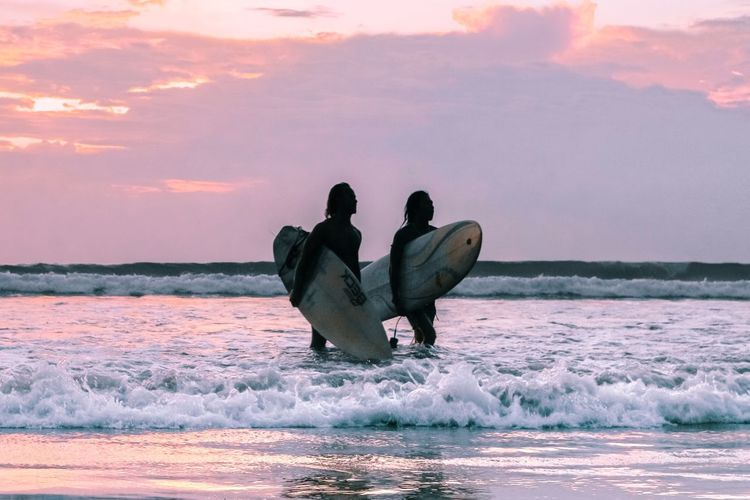 surfers in