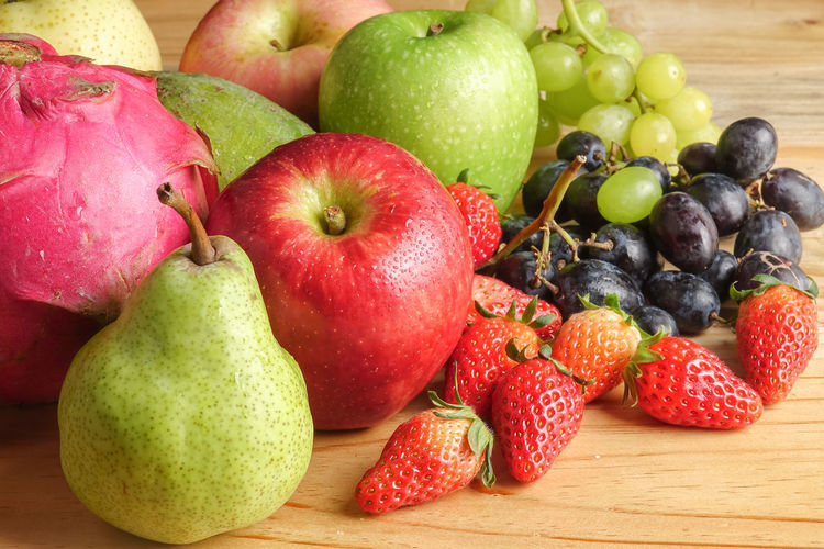 A SET OF FRUITS ON WOODEN TABLE