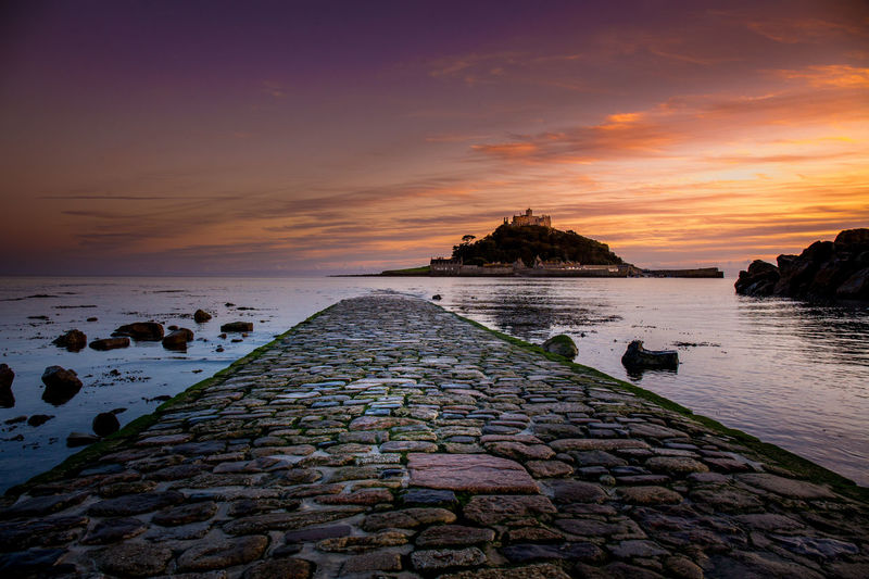 St Michaels Mount causeway sunset St Michaels Mount Architecture Beach Cornwall Sea Sky Sunset Tranquil Scene Travel Destinations Water