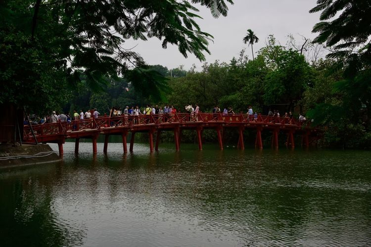 Vietnam Architecture Bridge Built Structure Crowd Day Group Of People Hanoi Lake Large Group Of People Leisure Activity Lifestyles Nature Outdoors Plant Real People Red Bridge Reflection Sky Tree Water Waterfront