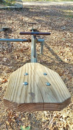 See Saw See Saws Playground Playground Equipment Toys Outdoors Playground Structure Childrens Park No People Sunlight Day Wooden Surface Seat Wooden Seats Wood Seat Outdoor Play Equipment Outdoor Fun Empty Seats Beauty In Nature Macro Close-up Trees Leaves Autumn Fall Day