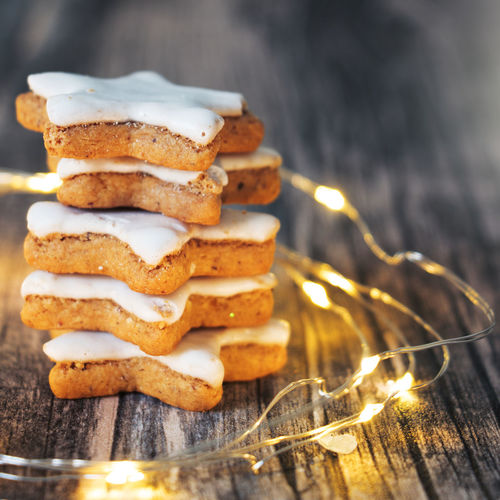 Christmas Square Backgrounds Baked Cinnamon Cinnamon Stars Cookie Decorated Food Food And Drink Led Lights  Light String Stack Star Star Shape Sweet Food Table Traditional Warm Clothing Wood - Material Wooden