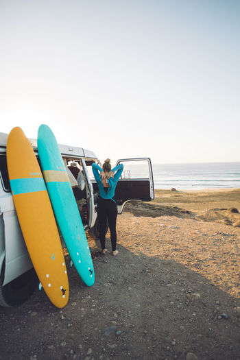 Getting ready for a sunset surf session in Fuerteventura. Land Sky Sea Beach Full Length Water Real People Leisure Activity Lifestyles Day Clear Sky Nature People Women Trip Sand Surfboard Men Outdoors Horizon Over Water Travel Travel Destinations Traveling Travel Photography Travelling Vwbulli VwT3 Volkswagen Camper Campervan Camper Van Surf Surfing Surfer Surfboards Fuerteventura Summer Summertime Sunset Sunset_collection Sun Girl Adventure Goldenhour Beachphotography Surfphotography Bulli Vanlife Vanlifers Wetsuit
