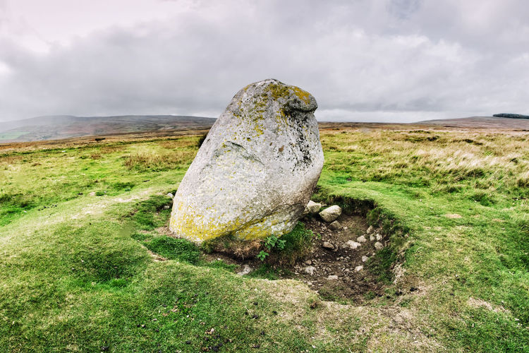 View of rock on land against sky