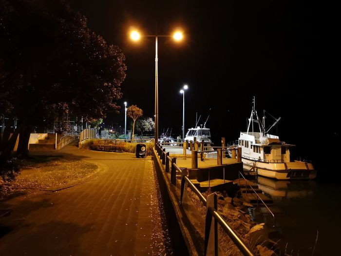 3am by the sea. Oil Pump Water Illuminated Nautical Vessel Shipyard Commercial Dock Harbor Street Light Moored Boat Dock