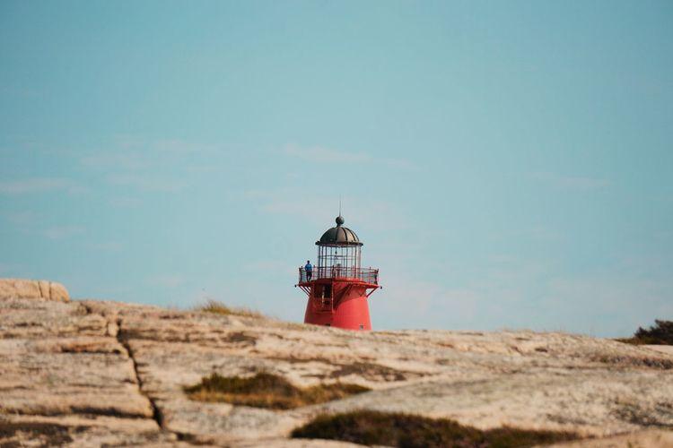 Lighthouse On Rock Against Sky