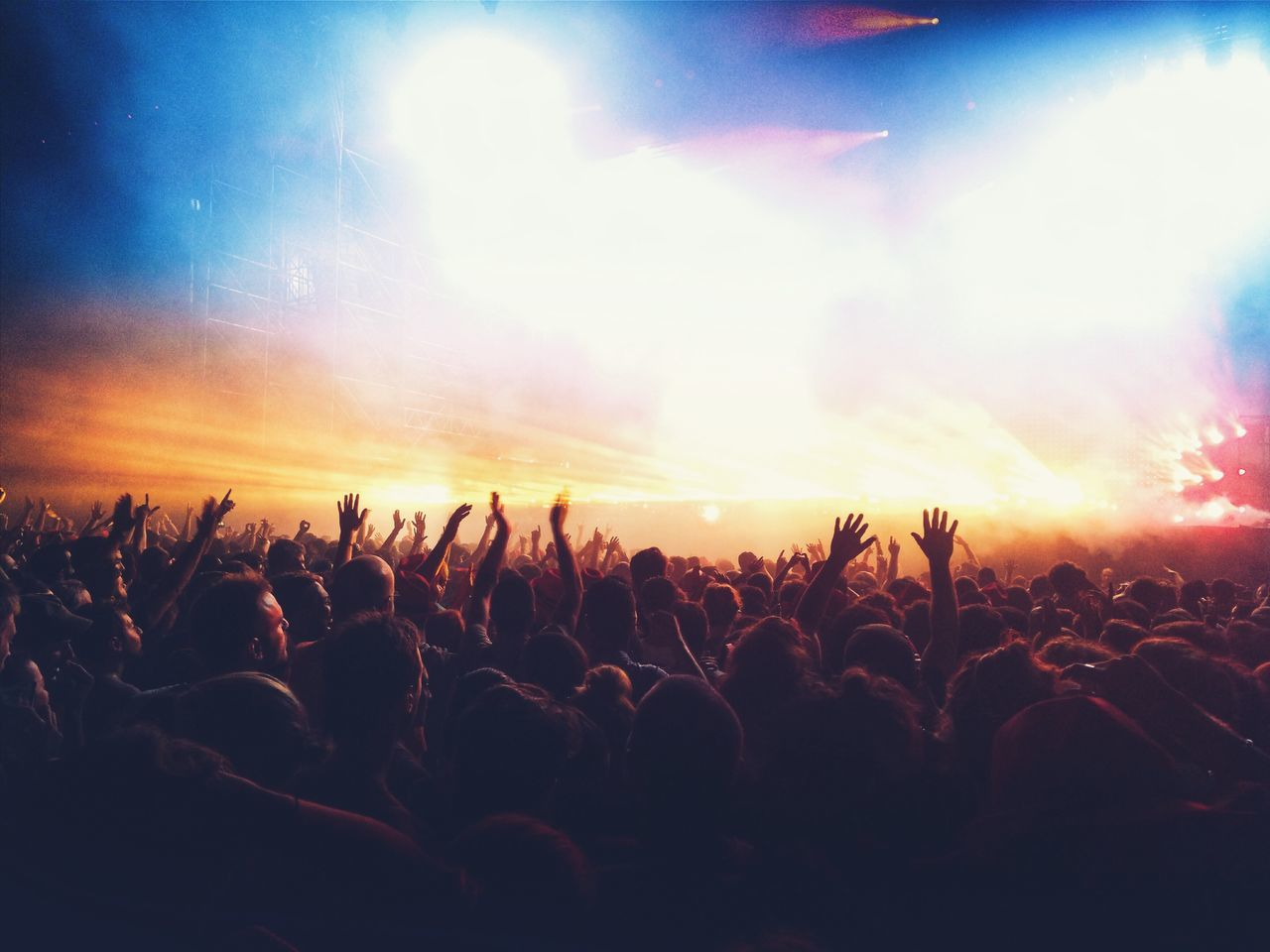 Crowd enjoying illuminated music concert at night