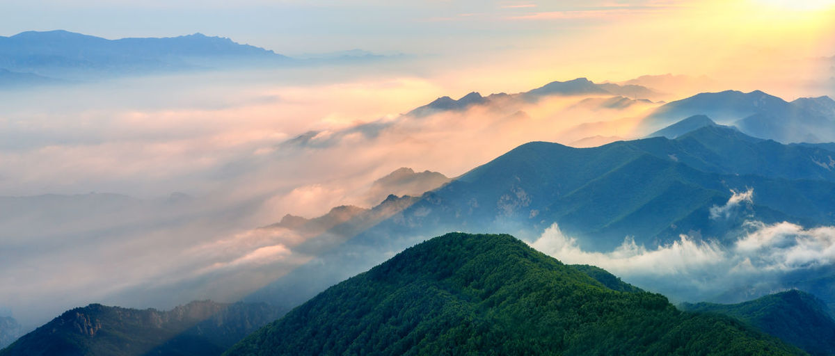 mountain layers at sun rise Cloudscape Panoramic Sunlight View Cloud - Sky Fog Landscape Layers Mist Mountain Mountain Peak Mountain Range Nature Nobody Outdoors Peak Sky Summer Sunrise Sunset