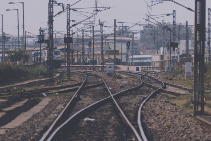 Blurry Image of Yamuna Railway Station, Agra, India Architecture Blurry Building Exterior Built Structure Cable Complexity Day Electricity  Electricity Pylon No People Outdoors Public Transportation Rail Transportation Railroad Track Sky Soft Focus Transportation Tree