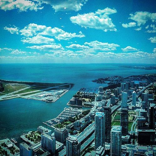 The view from the CN Tower. Cntower Toronto Touriststuff Lakeontario  Shoreline Airport 347meters Off the ground View Clouds Shadows