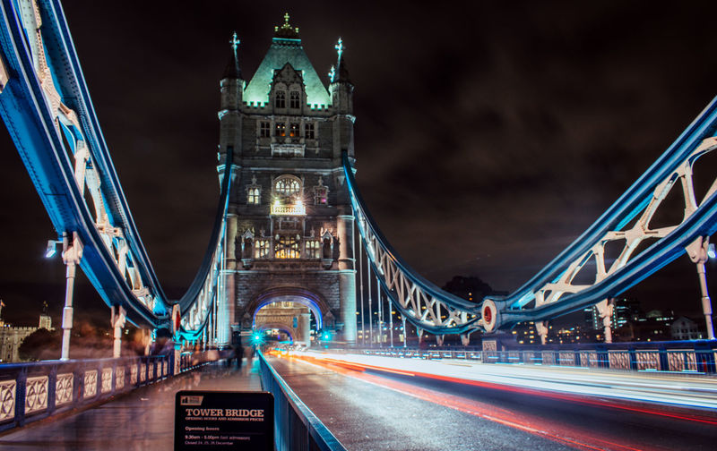 Architecture Blurred Motion Bridge - Man Made Structure Building Exterior Built Structure Chain Bridge City Connection High Street Illuminated Light Trail Long Exposure Motion Night No People Outdoors Road Sky Speed Suspension Bridge Transportation Travel Travel Destinations Connected By Travel