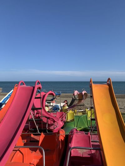 High angle view of slides at beach against sky