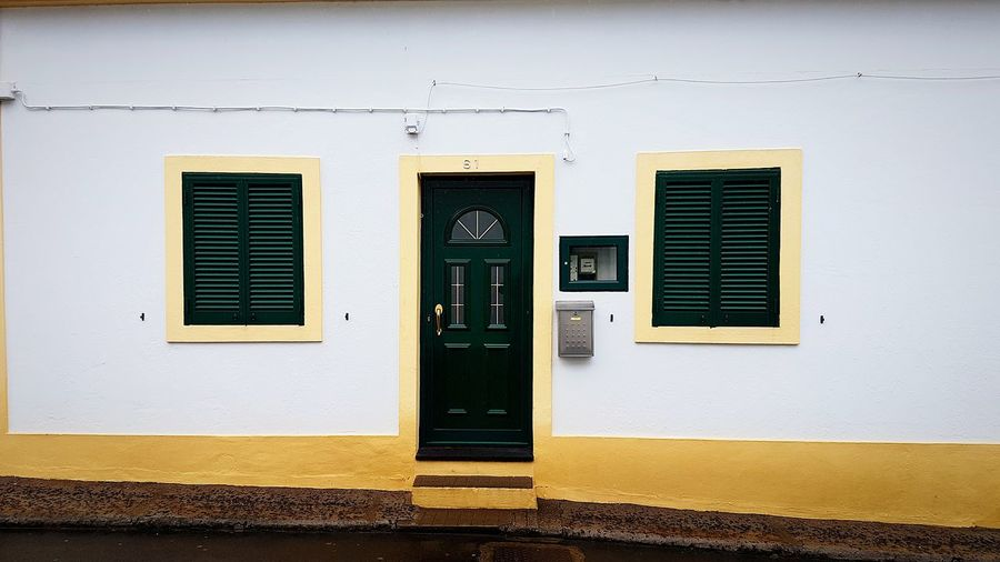 Minimalism Façade Minimalism Minimalist Architecture Azores Azores Islands Portugal Travel Photography Europe Travel EyeEm Best Shots Açores Furnas Architecture_collection Simplicity EyeEm Selects Yellow Door Architecture Building Exterior Built Structure Shutter Rusty The Architect - 2018 EyeEm Awards