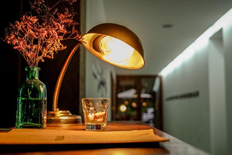 Illuminated electric lamp in dark room