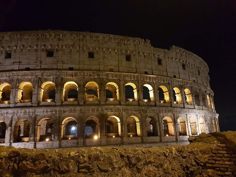The Colosseo by Night Travel Photography Rome Rome Italy Colosseum Colosseo Italy An Eye For Travel History Night Architecture Travel Destinations Tourism Arch Old Ruin Travel Illuminated Ancient Built Structure Arts Culture And Entertainment Outdoors Ancient Civilization Vacations No People Sky King - Royal Person The Graphic City EyeEmNewHere Moving Around Rome Adventures In The City