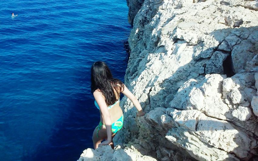 Cliff Diving Blue Cliff Adventure Jumping Island Cliff Jumping Sea People Woman In Bikini Looking At The Sea Summer Fun