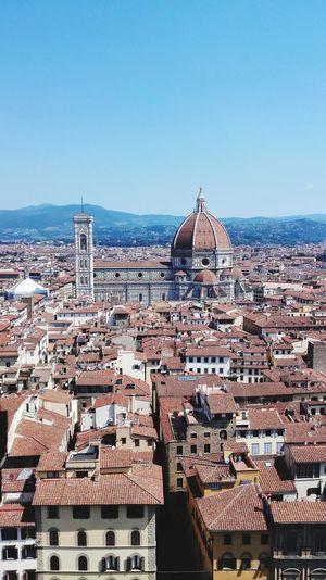High angle view of buildings amidst duomo santa maria del fiore