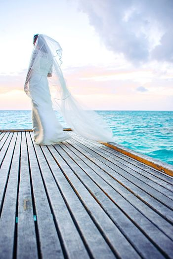 Sea Horizon Over Water Sky Water Nature One Person Leisure Activity Real People Beach Men Beauty In Nature Outdoors Day Vacations Scenics Cloud - Sky Low Section Maldives Boat Deck EyeEm Best Shots - Nature EyeEmBestPics EyeEm Gallery Ocean View Bride Wedding Dress The Creative - 2018 EyeEm Awards