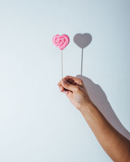 Celebration Close-up Heart Hearts Holding Human Hand Indoors  Light And Shadow Lollipop Minimalism One Person People Pink Color Simplicity Sweet Two Valentine's Day  White Background