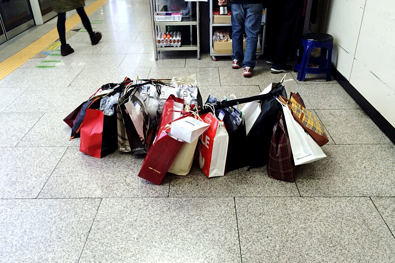High angle view of shopping bags on floor