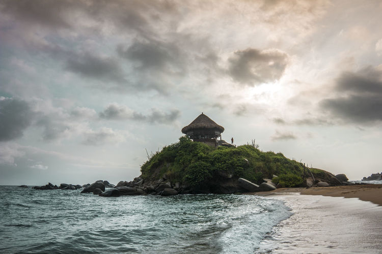 Tayrona national park in colombia Backpacking Colombia Tayrona Adventure Architecture Beach Beauty In Nature Building Building Exterior Built Structure Cloud - Sky Clouds Hut Land Nature Ocean Outdoors Rock Rock - Object Scenics - Nature Sea Sky Tranquil Scene Tropical Water