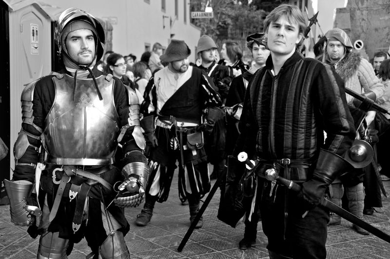 portrait of two men wearing medieval clothing during the parade Festa della Zucca Armor Arts Culture And Entertainment Blackandwhite Photography Historical Parade Medieval Clothing Men Only Men Outdoors People Portrait Streetphotography Welcome To Black