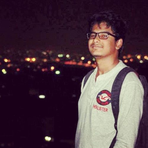 City lightsOn top off a mountainPhotographeredby abiClicked my smileThat  's my real smile :p