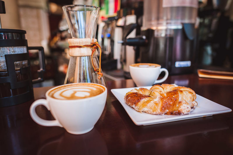 Breakfast Cafe Cafe Latte Coffee Coffee Coffee - Drink Coffee And Sweets Coffee Cup Coffee Shop Coffee Time Cup Europe Focus On Foreground Freshness Froth Art Frothy Drink Latte Latteart Pastry Ready-to-eat Refreshment Saucer SPAIN Still Life Sweet Food