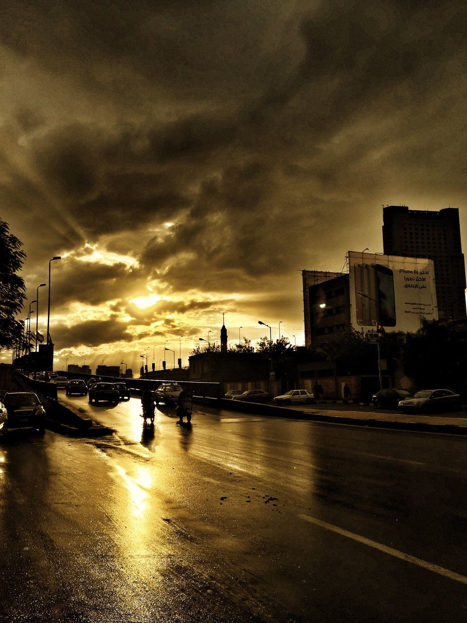 sky, cloud - sky, sunset, architecture, built structure, city, building exterior, storm cloud, city life, outdoors, no people, transportation, water, travel destinations, illuminated, skyscraper, cityscape, nature, day