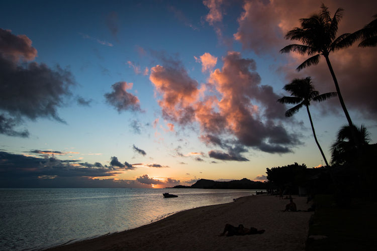 matira beach on bora bora at evening Bora Bora  French Polynesia Pacific Travel Beach Beauty In Nature Cloud - Sky Horizon Over Water Lagoon Land No People Palm Tree Plant Scenics - Nature Sea Silhouette Sky Sunset Tahiti Tranquil Scene Travel Destinations Tree Water The Traveler - 2018 EyeEm Awards HUAWEI Photo Award: After Dark