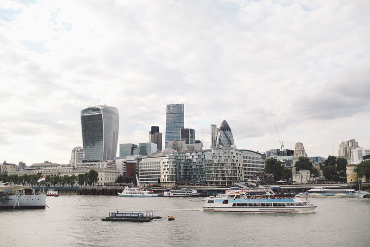 30 st mary axe by thames river against sky in city