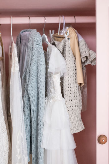 various clothes to the pink wardrobe Hanging Variation Clothing Coathanger Dress Hunger Collection Still Life Closet Pink Color Wardrobe Warm Clothing Retail Display Womenswear In A Row Clothes Rack Store Shopping Textile White Color Fashion Indoors  Choice Retail  Wedding Holiday Moments
