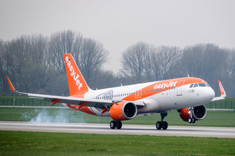 Aviation Aviationphotography Aircraft Special Livery EasyJet A320Neo Cloudy Airbus A320 Landing - Touching Down Touching Down Planespotting Finkenwerder Airbus Airplane Aerospace Industry Airport Runway Air Vehicle Airport Aircraft Wing Sky Plane