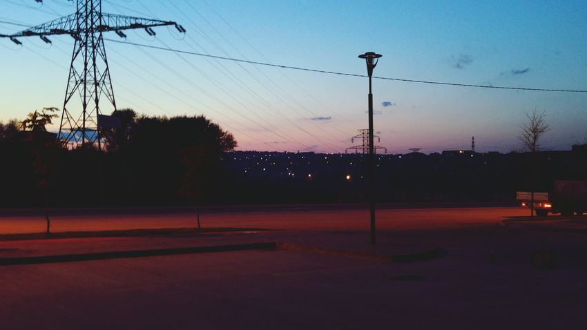 Electricity  Electricity Pylon Electric Wires Lighting Equipment Streetphotography Almostnight Landscape_photography Sunset Peaceful View EyeEmBestEdits Eyeemphotography Home Is Where The Art Is