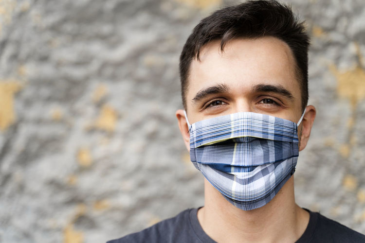 Portrait of young man covering face