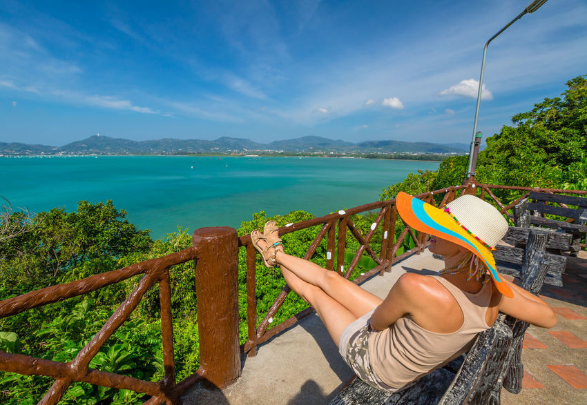 Back of happy and fashionable tourist woman with colorful sarong in turquoise water of Maya Bay famous lagoon of The Beach movie, Phi Phi Leh, Andaman Sea in Thailand Fashionable and happy tourist with sarong and pink wide-brimmed hat making a selfie on tropical famous beach of Nai Harn Beach, Rawai, Phuket, Thailand. Happy tourist enjoys panorama from Sail Rock View Point of kor 8 of Similan Islands National Park, Phang Nga, Thailand, one of the tourist attraction of the Andaman Sea. Happy woman with bikini and shorts, jumping in the air on Ya Nui Beach, a little cove divided by a rocky cape, Phuket, Thailand, Asia. Happy Koh Rok Islands Nui Beach Phang Nga Bay Phuket Thailand Tanning ☀ Thailand Vacations Woman Adult Beach Beauty In Nature Day Girl Human Hand Koh Rok Leisure Activity Lifestyles Low Section Men Mode Of Transport Mountain Nature Nautical Vessel One Person Outdoors People Phang Nga Rawai Real People Scenics Sea Seascape Sitting Sky Surin Islands Transportation Travel Destinations Tree Water Women
