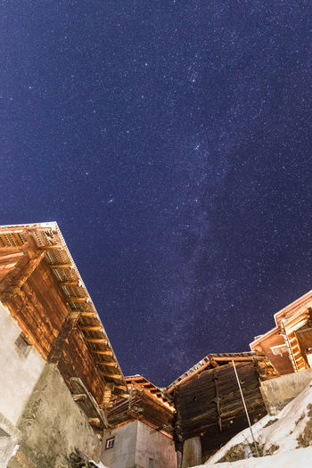 Swiss Milky Way Night Sky Stars Milky Way Switzerland Cottages Village Mountain Winter Dark No People Outdoors Long Exposure Wide Angle Architecture Low Angle View Built Structure Space Cold Temperature Nature